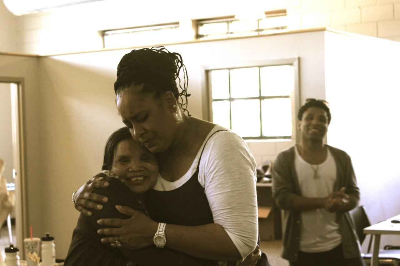 Peta~Gaye ministering to a Vietnamese Refugee