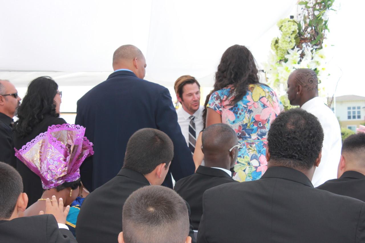 Pastor Jude Fouquier Praying over Justin and Rachel